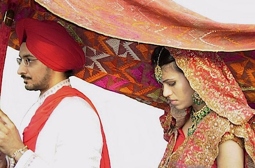 Punjabi bride under phulkari fabric