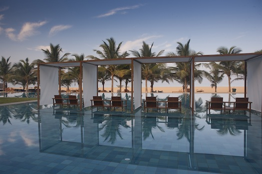 Relax on Water on chairs inside pool at Jetwings Blue Negombo