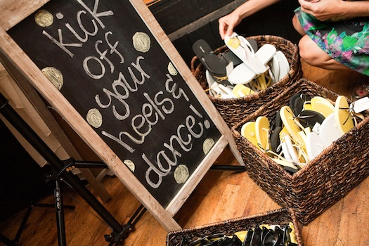 flipflops at wedding with signage